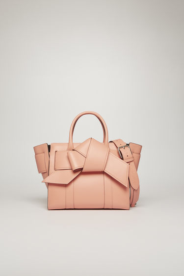 Acne Studios launches a collection of bags and accessories with Mulberry. The Small Musubi Bayswater bag is crafted from soft calf leather with a debossed co-branded logo and has a knotted strap wrapped around the sides.