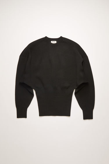 Acne Studios black sweater is shaped with dolman sleeves and a wide, ribbed waist.