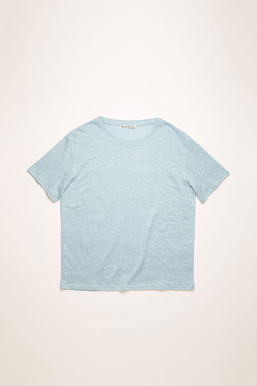 Acne Studios powder blue t-shirt is crafted from lightweight slubbed linen and shaped to a relaxed fit with dropped shoulder seams.