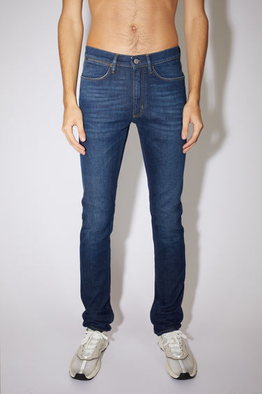 Acne Studios dark blue jeans are made from comfort stretch denim with a low rise and a slim leg.