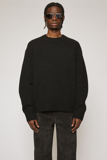 Acne Studios black sweater is knitted from soft wool-blend and completed with a ribbed crew neck, cuffs and hem.