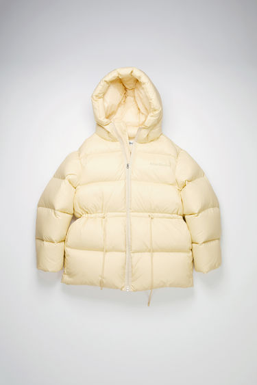 Acne Studios cream beige puffer coat is made from ripstop shell filled with recycled down and feathers and features two front pockets, a quilted hood and adjustable drawstring toggle at the waist for a personalised fit.