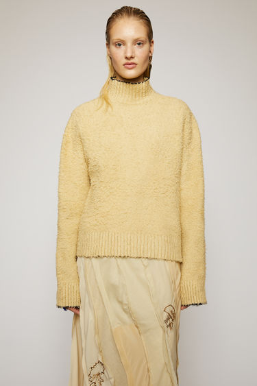 Acne Studios sand beige polo neck sweater is crafted from a cotton-blend that's been brushed to a shaggy texture and shaped to an oversized fit with dropped shoulders.