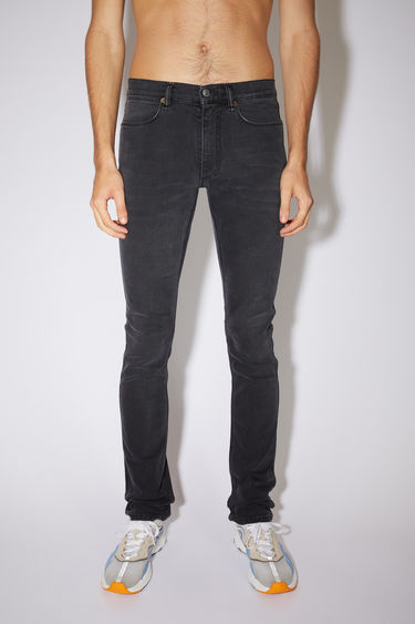 Acne Studios used black jeans are made from comfort stretch denim with a low rise and a slim leg.