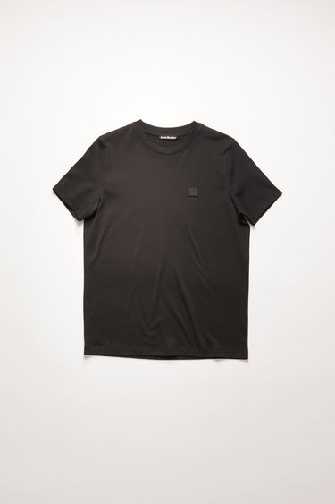 Acne Studios black crew neck t-shirt is made of organic cotton with a face logo patch and ribbed neckline.