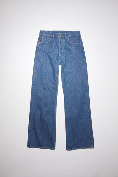 Acne Studios 2021F dark blue trash jeans are made from from rigid denim with a mid rise and a loose leg, cut to a relaxed, bootcut silhouette.