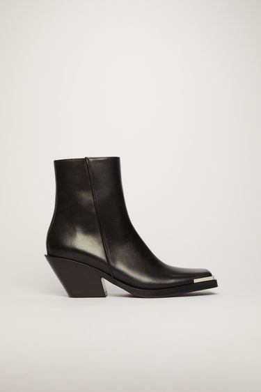 Acne Studios black ankle boots crafted from smooth calf leather and shaped with slanted block heel and squared toe.