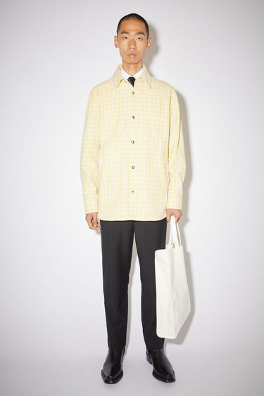 Acne Studios vanilla yellow/pale yellow pocket overshirt is made of a checked cotton/wool blend and has a boxy fit.