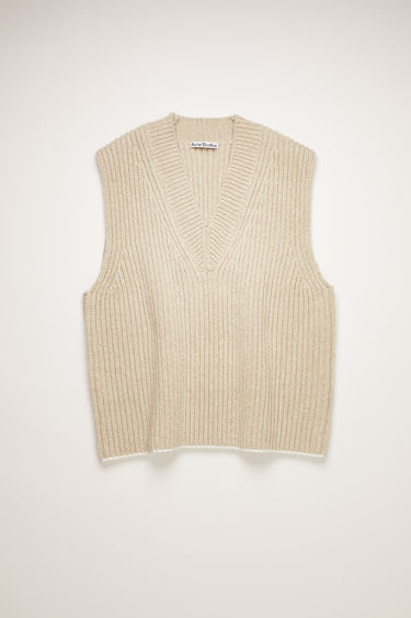 Acne Studios ecru beige vest is spun from a blend of wool and silk in a thick ribbed knit with a deep V-neck and shaped to an oversized silhouette with dropped armholes.