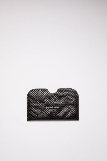 Acne Studios black card holder is made of calf leather with a silver logo stamp.