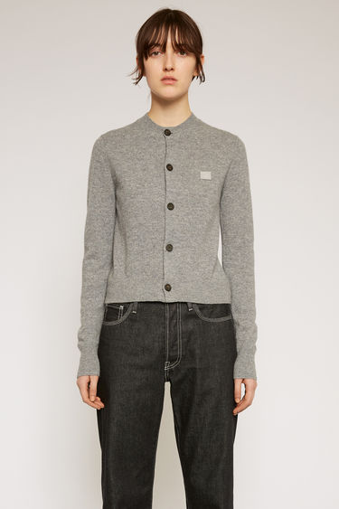 Acne Studios grey melange cardigan is knitted in a fine gauge from soft wool yarns and accented with a tonal face-embroidered patch on the chest.