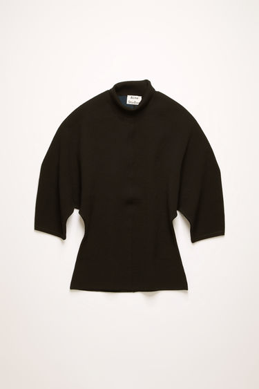 Acne Studios black sweater is crafted from a double faced wool blend knit. It's shaped to a form-skimming fit with a high neckline, and is offset with short, blouson sleeves.