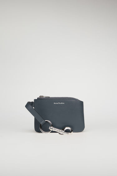 Acne Studios dark blue purse is crafted in a rectangular shape with a metal zip closure and secured with a logo-engraved lobster clasp that allows it to be attached to your key ring or belt loop.