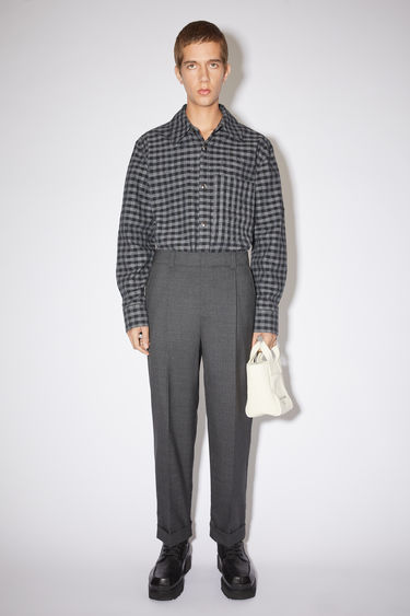 Acne Studios dark grey melange casual trousers are made of wool with a tapered fit.