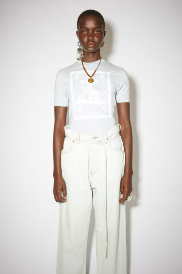 Acne Studios ice blue crew neck t-shirt is made of organic cotton with a printed design on the front.