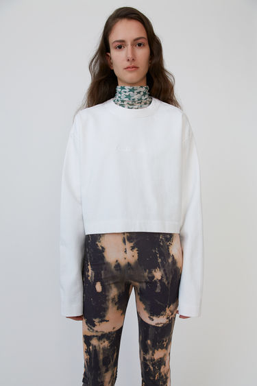 Acne Studios Odice Emboss optic white is a cropped sweatshirt with an embossed logo on the chest.