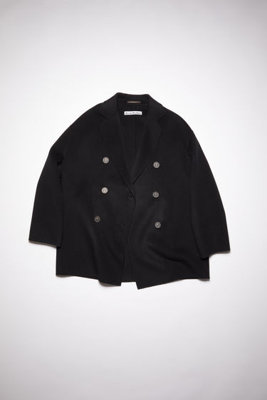 Acne Studios black double-breasted coat is crafted from double-faced wool to a relaxed silhouette with dropped shoulder seams and notch lapels.