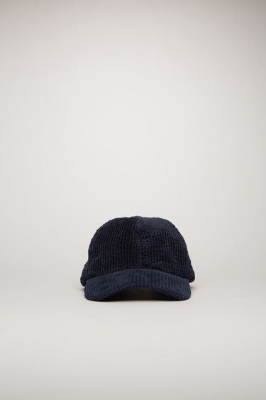 Acne Studios navy blue corduroy cap is crafted to a six-panel design and has an adjustable buckle strap and a logo-engraved metal plaque at the back.