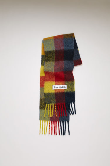 Acne Studios red/yellow/dark blue checked scarf is spun from alpaca, wool and mohair yarns to a wide dimension and features a stitched logo patch above the fringed edges.