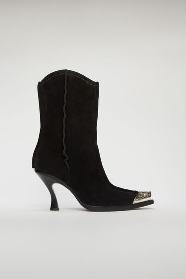 Acne Studios black suede boots are crafted to a Western-inflected silhouette with a stiletto heel and accented with engraved silver-tone metal plaque toe cap.