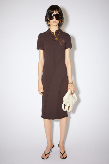 Acne Studios dark brown pique polo dress is made of cotton with a straight fit.
