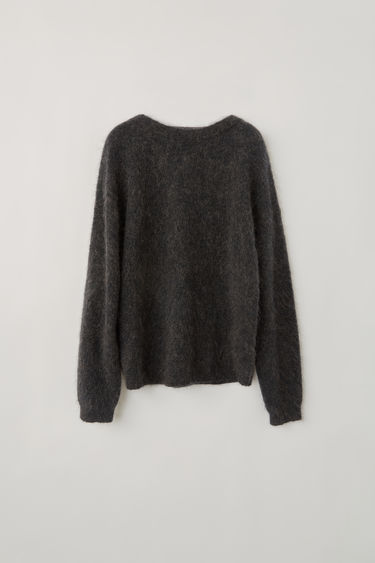 Acne Studios Dramatic Mohair warm charcoal sweater is shaped for an oversized fit. It's knitted with elements of soft wool and mohair, and finished with classic ribbed trims.