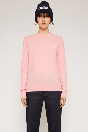 Acne Studios blush pink sweater is finely knitted from pure wool and finished with a tonal face-embroidered patch and ribbed trims.