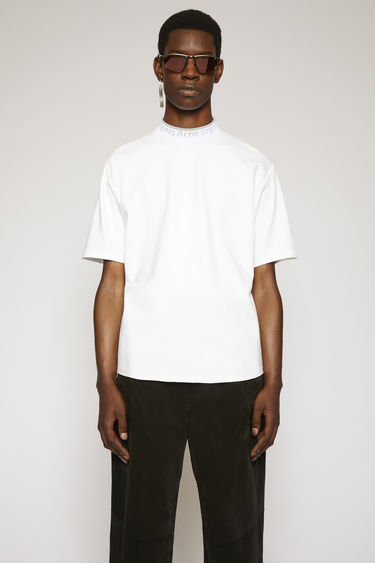 Acne Studios optic white t-shirt is crafted to an oversized fit from technical brushed jersey and detailed with a ribbed logo-neck trim.