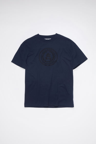 Acne Studios navy crew neck t-shirt is made of cotton with an embroidered logo design on the front.