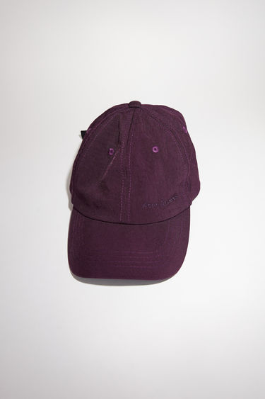 Acne Studios maroon red baseball cap has a classic six panel design, featuring a logo embroidery on the front.