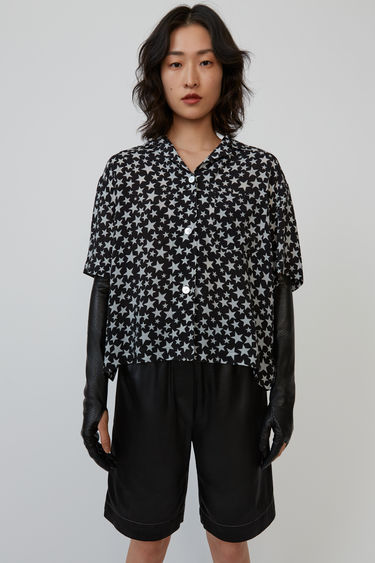 Acne Studios black/grey bowling shirt is cut to a boxy silhouette and patterned with the seasonal star print.