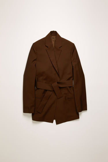 Acne Studios chocolate brown suit jacket is crafted from a lightweight wool and mohair blend and features a concealed double-breasted placket and a matching tie belt.