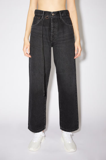Acne Studios vintage black jeans are made from rigid denim with a deep rise and a loose leg.