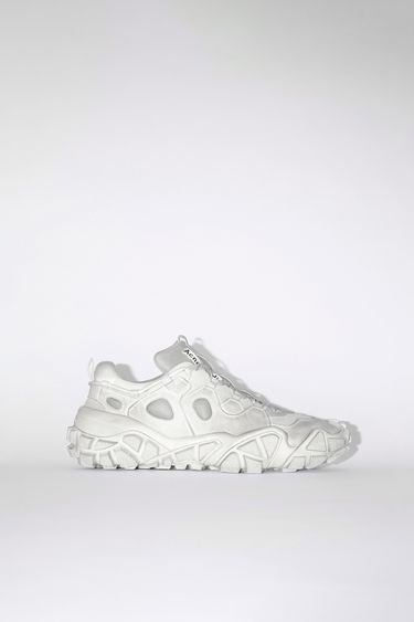 Acne Studios Bolzter W Tumbled white sneakers are crafted from mesh with faux-suede overlays, and set on chunky tread soles. Every pair is individually garment dyed to create a well-worn finish.