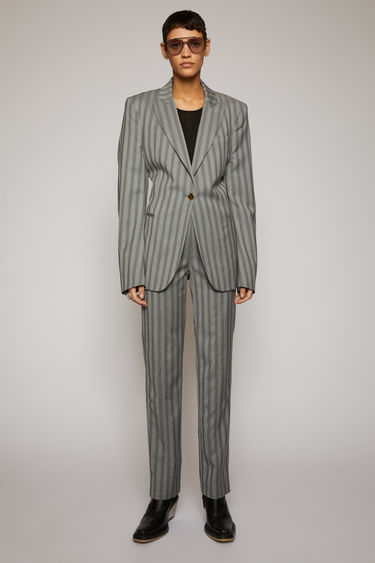 Acne Studios light grey suit jacket is crafted from pinstriped wool with notched lapels and structured with dartings at the back.
