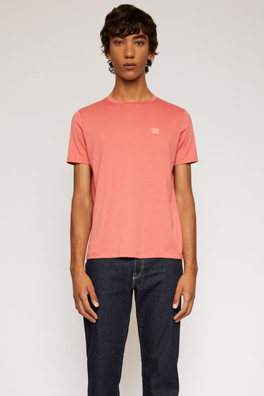 Acne Studios pale red t-shirt is cut to a slim silhouette in lightweight cotton jersey and finished with a tonal face-embroidered patch on the chest.