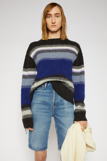 Acne Studios black/multi sweater is knitted from alpaca and wool-blend and features a multicoloured stripe pattern. It's shaped to a relaxed, boxy shape with dropped sleeves, then finished with ribbed edges.