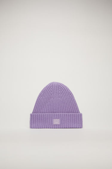 Acne Studios Mini Pansy N Face lavender purple beanie is rib-knitted from soft wool and detailed with a face-embroidered patch on the turn-up brim.