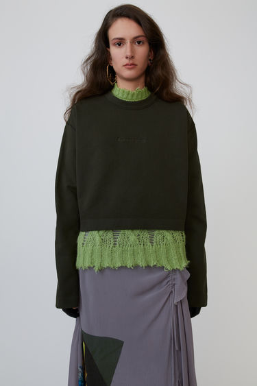 Acne Studios Odice Emboss forest green is a cropped sweatshirt with an embossed logo on the chest.