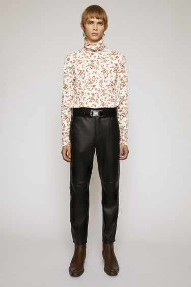 Acne Studios black trousers are crafted from a soft lamb leather to a cropped, straight fit and finished with classic five-pocket construction.