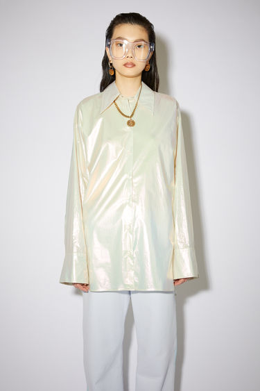 Acne Studios white long sleeve shirt is made of pearlised cotton with a relaxed fit.