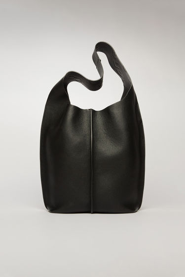 Acne Studios black tote bag is crafted from supple grain leather and has a silver-tone metal clasp which opens to reveal a spacious logo-embossed leather lining with a detachable zip pouch.