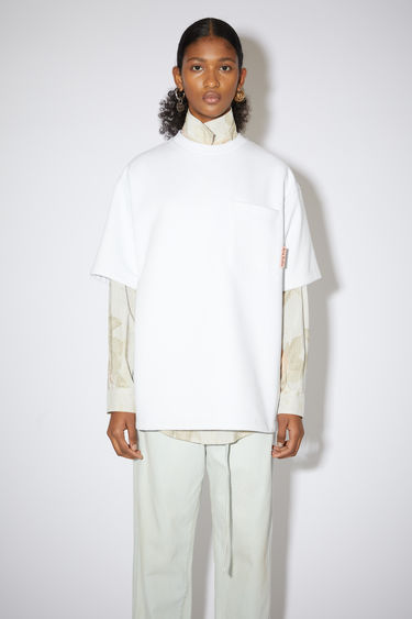Acne Studios optic white short sleeve sweatshirt features a ribbed crew neck, a single chest pocket, and an Acne Studios logo tab.