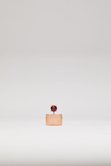Acne Studios red/pink earring is crafted with a gold-tone curved stem and embellished with a round crystal stud and a rectangular, marbled stone.