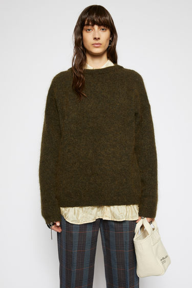 Acne Studios olive green sweater is knitted from soft wool and mohair-blend yarn and has a ribbed crew neckline and dropped shoulders to create a relaxed silhouette.