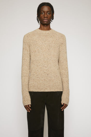 Acne Studios brown melange sweater is designed to look like an old favourite. It's made from a soft wool and cashmere blend with a pilled texture and finished with ribbed trims.