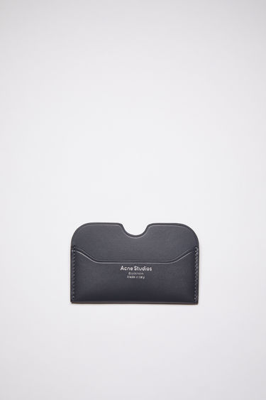 Acne Studios dark blue card holder is made of soft grained leather with a silver logo stamp.