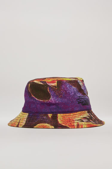 Acne Studios launches an exclusive capsule with Monster in My PocketⓇ. As part of the collaboration, this multi orange bucket hat is crafted from cotton-canvas and features a print of a werewolf. It's shaped with a flat-topped crown and a quilted brim.