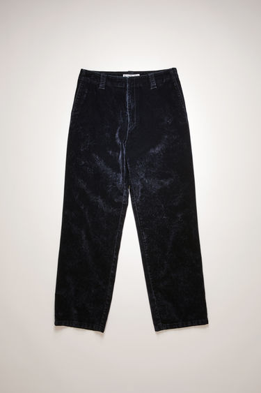 Acne Studios navy trousers are crafted to a relaxed silhouette with straight legs from flocked denim and features a leather patch pocket at the back.