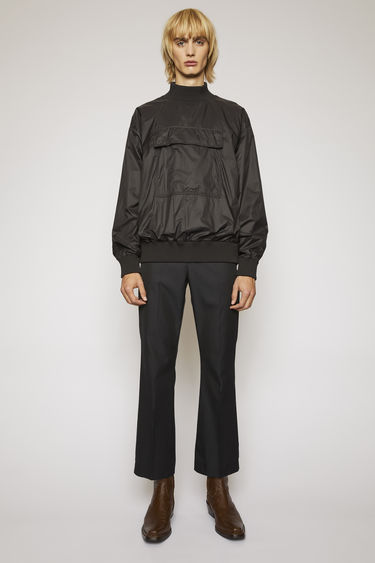 Acne Studios black anorak is crafted from matte ripstop with mesh lining and has a large patch pocket, ribbed collar and a zipped side seam.